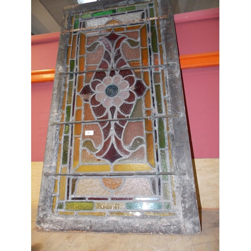 31 - A VINTAGE LEADED STAINED GLASS WINDOW MEASURING APPROX 2FT X 35