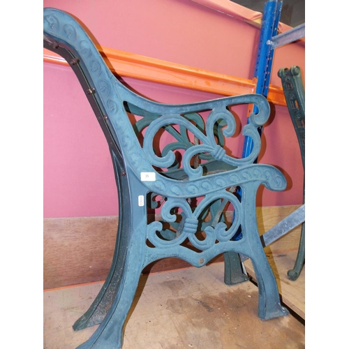 35 - A PAIR OF GREEN PAINTED CAST IRON ORNATE GARDEN BENCH ENDS...