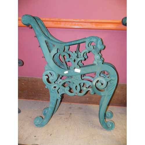 36 - A PAIR OF GREEN PAINTED CAST IRON ORNATE GARDEN BENCH ENDS...