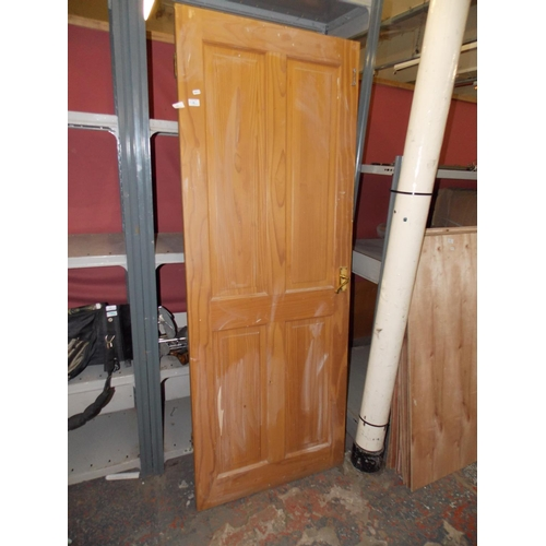 45 - A PINE WOOD INTERIOR PANELED DOOR MEASURING 40 X 78