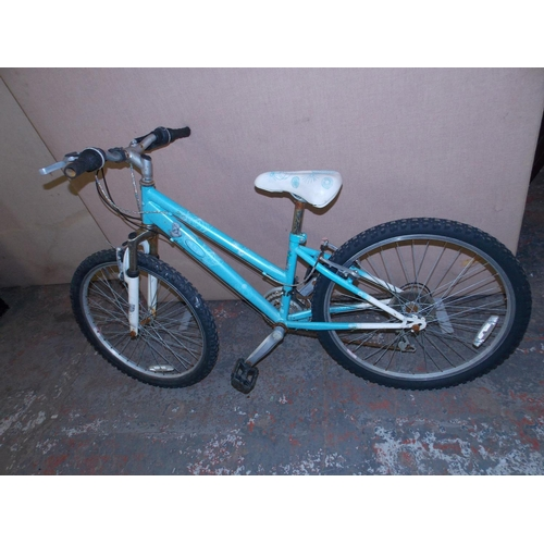 5 - A BLUE ME TO YOU GIRLS MOUNTAIN BIKE WITH FRONT SUSPENSION AND 18 SPEED SHIMANO GEAR SYSTEM...