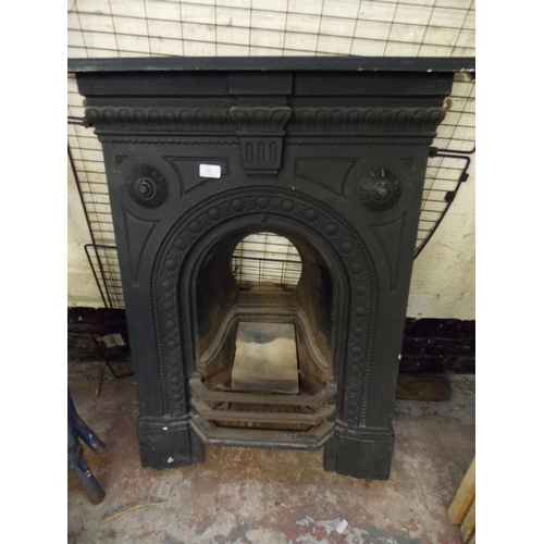 53 - A VICTORIAN CAST IRON ORNATE FIREPLACE AND A LARGE FIRE GUARD...