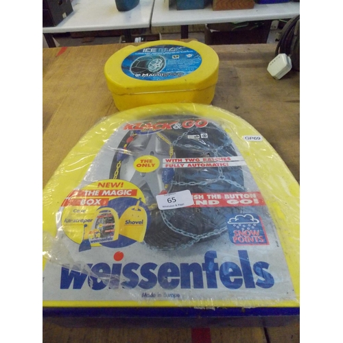 65 - TWO CASED SETS OF CAR SNOW CHAINS - ONE ICE BLOCK AND ONE OTHER...