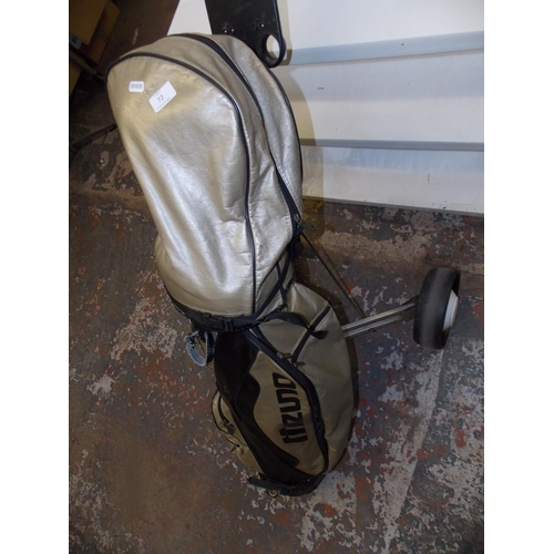 72 - A GOLF KING TROLLEY AND BAG CONTAINING FORGAN GOLF CLUBS...
