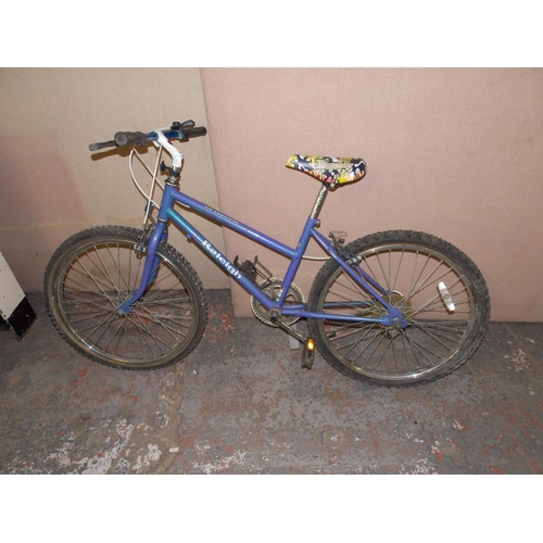 8 - A PURPLE RALEIGH RHAPSODY GIRLS MOUNTAIN BIKE WITH 5 SPEED SHIMANO GEAR SYSTEM...