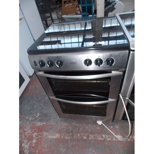 113A - A BLACK AND STAINLESS BELLING GAS COOKER WITH DOUBLE OVEN...