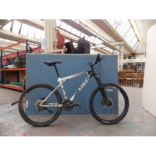 A Black And White Gt Aggressor Kc2 Gents Mountain Bike With Front