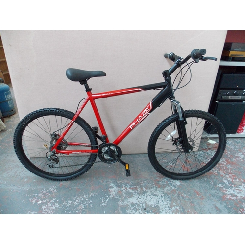 a black and red apollo phase gents mountain bike with. Black Bedroom Furniture Sets. Home Design Ideas
