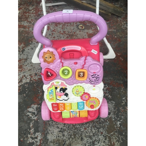 15 - A SELECTION OF BABY ITEMS TO INCLUDE GRACO HIGH CHAIR, VTECH FIRST STEPS BABY WALKER, TOYS ETC...