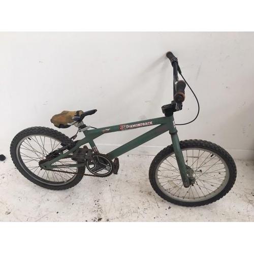 2 - A GREEN DIAMONDBACK BMX BIKE...