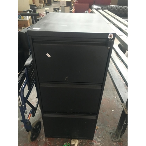 22 - A BLACK METAL TRIUMPH THREE DRAWER OFFICE FILING CABINET (KEY IN OFFICE)...