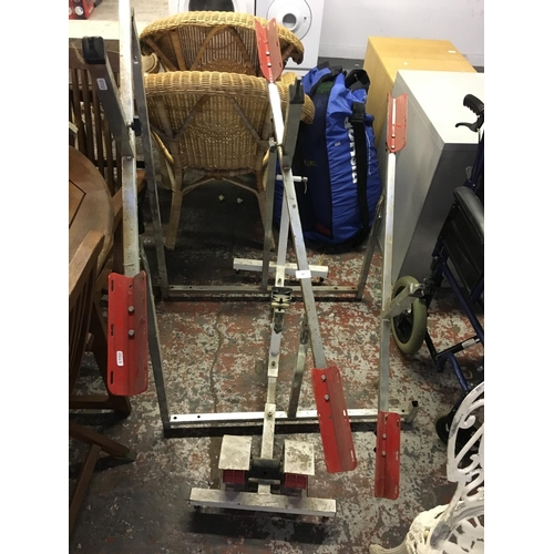 10 - TWO ITEMS TO INCLUDE A TRIPLE BICYCLE STAND AND A BICYCLE TRAINING MACHINE...