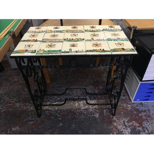 20 - A BLACK WROUGHT IRON ORNATE CONSERVATORY TABLE WITH INLAID ROYAL TILE TOP...