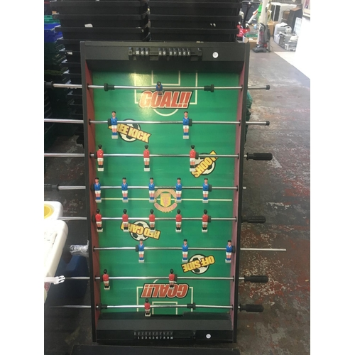 34 - A 4' X 2' MANCHESTER UNITED FOOTBALL TABLE AND T-SHIRT...