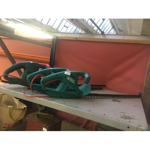 43 - THREE GREEN BOSCH ELECTRIC HEDGE TRIMMERS TO INCLUDE AN AHS 60-16, AHS 45-16 AND A AHS 6316C...