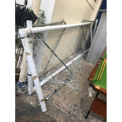 18 - TWO WHITE HARROD FOLDING FOOTBALL GOAL POSTS MEASURING APPROX 12ft 7in X 4ft 5in...