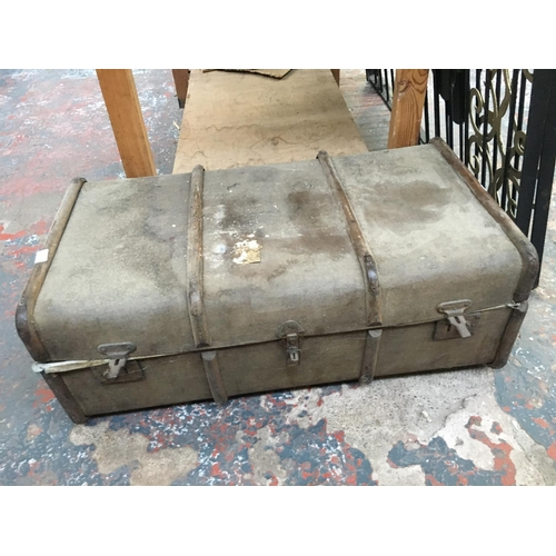 44 - A VINTAGE CANVAS TRUNK...