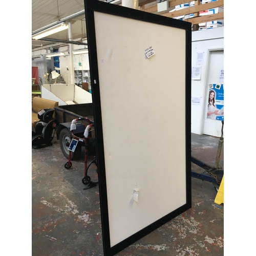 16 - A LARGE VELVET FRAMED HIGH QUALITY PROJECTOR SCREEN MEASURING APPROX 6ft x 3ft AND AN INFOCUS SCREEN...