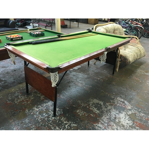 21 - A 6ft x 3ft SNOOKER TABLE WITH FOLDING LEGS TOGETHER WITH TWO CUES...