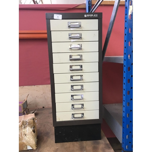 26 - A BROWN AND CREAM BISLEY TEN DRAWER OFFICE FILING CABINET...