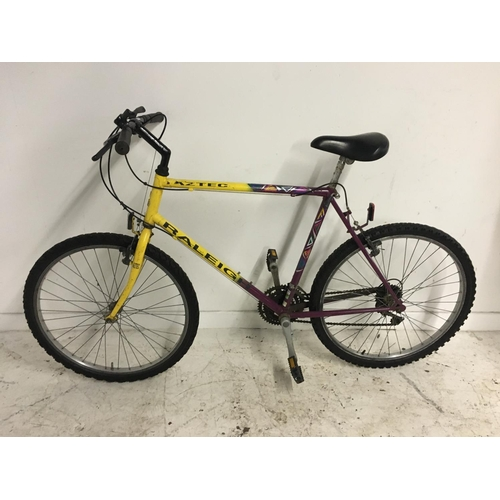 3 - A YELLOW AND PURPLE RALEIGH AZTEC GENTS MOUNTAIN BIKE WITH TWENTY ONE SPEED SHIMANO GEAR SYSTEM...