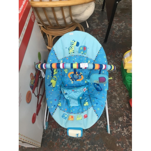 13 - TWO BABY ITEMS TO INCLUDE A BOXED CHAD VALLEY RAINBOW WALKER AND A BRIGHT STARTS BABY BOUNCER...