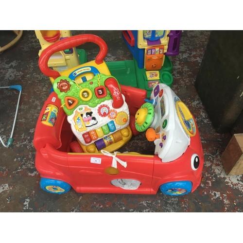 14 - THREE BABY ITEMS TO INCLUDE A VTECH FIRST STEPS BABY WALKER, A SIT IN CAR ACTIVITY CENTRE AND A FISH...