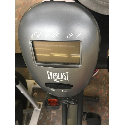 27 - A BLACK EVERLAST EXERCISE BIKE WITH DIGITAL READOUT (W/O)...