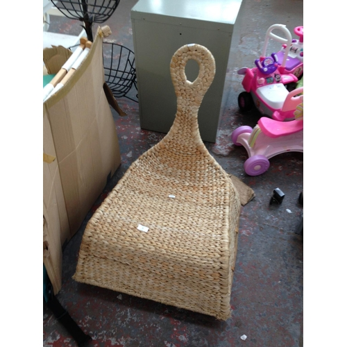 30 - A GOOD QUALITY ROCKING WICKER CHAIR ON METAL SUPPORT...