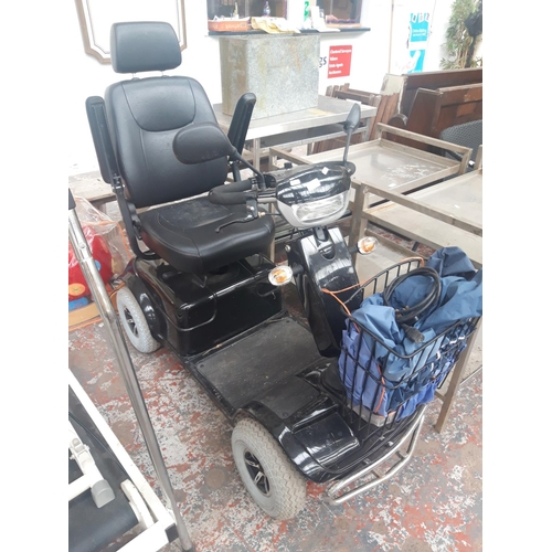 19 - A LARGE GOOD QUALITY BLACK FOUR WHEELED MOBILITY SCOOTER WITH CHARGER (W/O) REQUIRES NEW IGNITION...