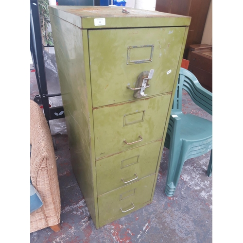 27 - A VINTAGE GREEN METAL FOUR DRAWER OFFICE FILING CABINET...