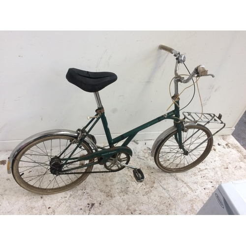 12 - TWO VINTAGE LADIES SHOPPING BIKES, ONE WHITE RALEIGH FOLDING BIKE WITH 3 SPEED GEAR SYSTEM AND ONE G...