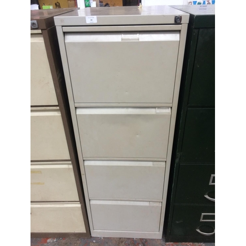 24 - A GREY METAL FOUR DRAWER OFFICE FILING CABINET...