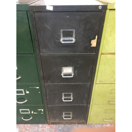 26 - A BLACK METAL FOUR DRAWER OFFICE FILING CABINET...