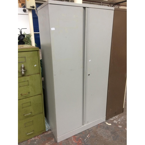 28 - A LARGE GREY METAL TWO DOOR OFFICE STORAGE CABINET...
