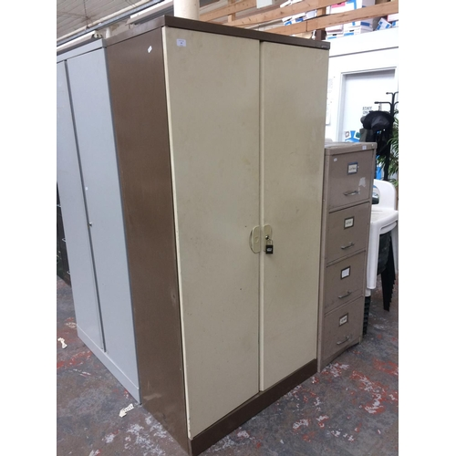 29 - A BISLEY BROWN AND CREAM METAL TWO DOOR OFFICE STORAGE CABINET WITH KEY...