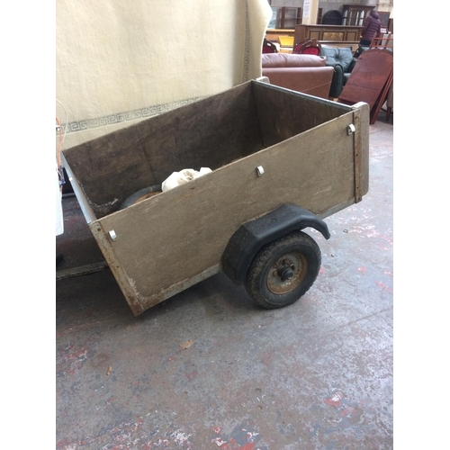 30 - A TWO WHEELED WOODEN CAR TRAILER MEASURING APPROX 4' x 3' x 18