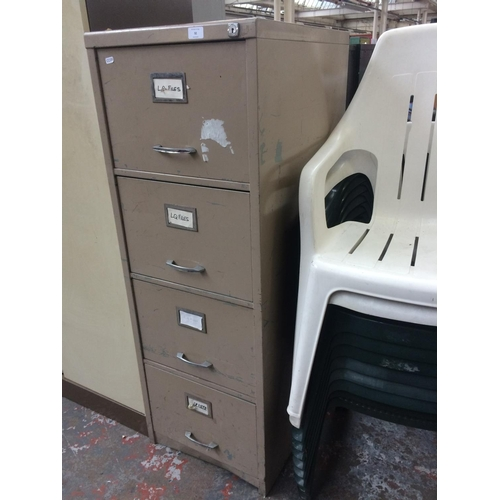 32 - A GREY METAL FOUR DRAWER OFFICE FILING CABINET...
