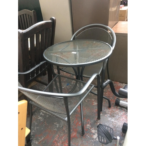 39 - A THREE PIECE GREY METAL MESHED PATIO SET COMPRISING OF A CIRCULAR PEDESTAL TABLE AND TWO MATCHING A...