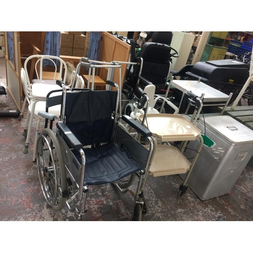 42 - A GOOD SELECTION OF TWELVE ITEMS OF MOBILITY EQUIPMENT TO INCLUDE A DMA WHEELCHAIR, BATH SEATS, WALK...