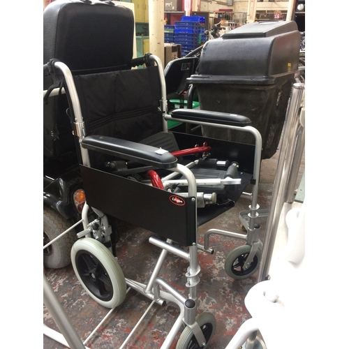 42A - A BLACK AND GREY ENIGMA WHEELCHAIR WITH BRAKES...