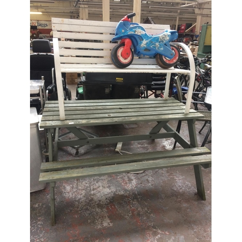 44 - THREE ITEMS TO INCLUDE A GREEN STAINED PUB STYLE GARDEN BENCH, A BLUE SPIDERMAN BALANCE BIKE AND A T...
