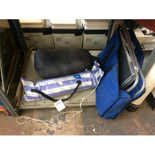 50 - THREE ITEMS TO INCLUDE A FOLDING CAMPING TABLE, A BAGGED HIGH GEAR DOUBLE SLEEPING BAG AND A BAGGED ...