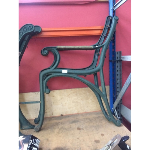 53 - A PAIR OF GREEN PAINTED CAST IRON ORNATE GARDEN BENCH ENDS...