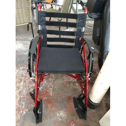 16 - A GOOD QUALITY RED DRIVE MEDICAL SPORT WHEELCHAIR AND TWO SPARE WHEELS...