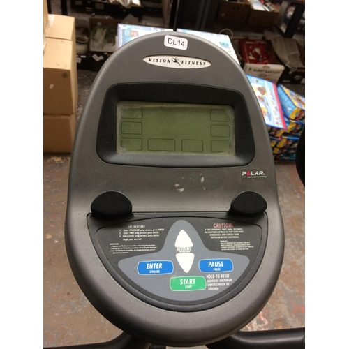 21 - A GREY VISION FITNESS EXERCISE BIKE WITH DIGITAL READOUT...
