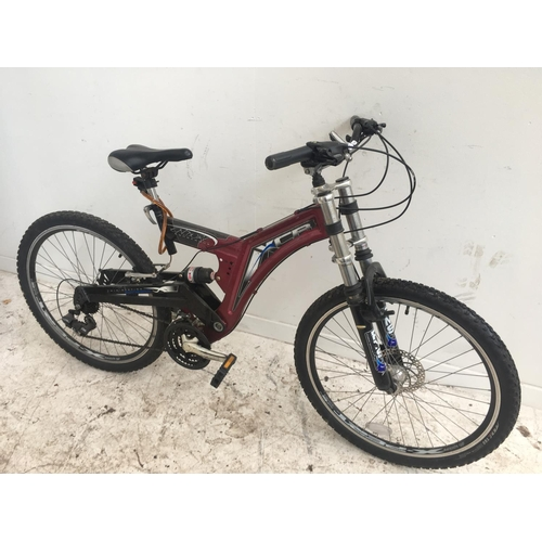 10 - A PURPLE CONCEPT GENTS DUAL SUSPENSION MOUNTAIN BIKE WITH FRONT DISC BRAKES AND TWENTY ONE SPEED SHI...