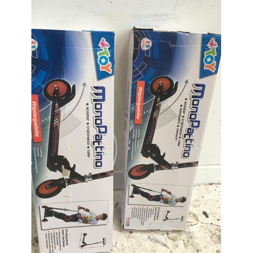 17 - TWO BOXED W TOY TWO WHEELED STUNT SCOOTERS...
