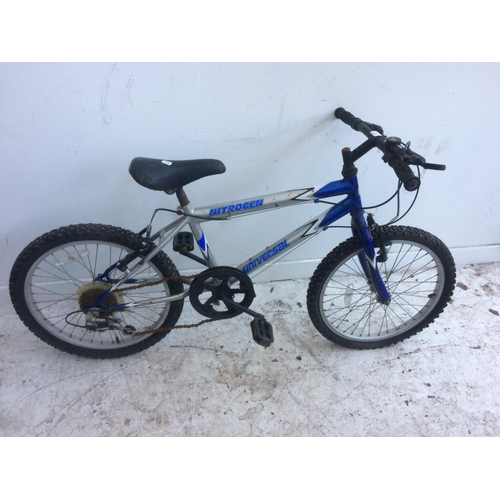 12 - A BLUE AND SILVER BOYS MOUNTAIN BIKE WITH 6 SPEED SHIMANO GEAR SYSTEM...