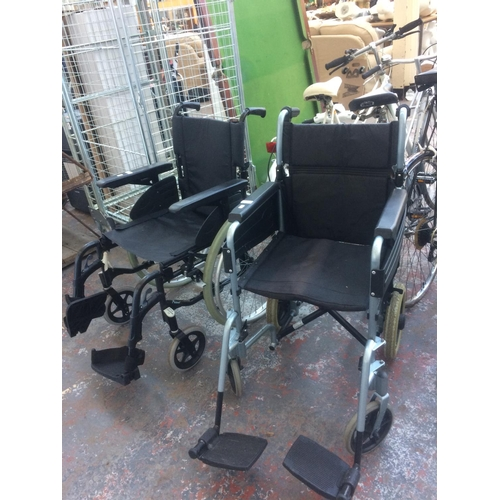 56 - TWO WHEELCHAIRS, ONE BLACK ACTION 2 AND ONE GREY AND BLACK ESCAPE...